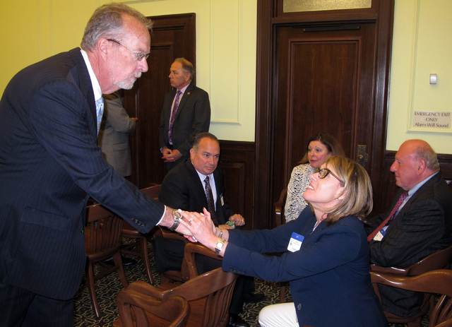 State Sen. James Whelan, left, speaks with members of a coalition formed to defeat a November ballot question that would authorize two new casinos in northern New Jersey,  Monday June 13, 2016, in ...
