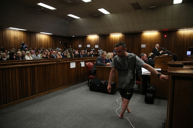 Oscar Pistorius walks on his stumps during argument in mitigation of sentence by his defense attorney Barry Roux in the High Court in Pretoria, South Africa, Wednesday, June 15, 2016. (Siphiwe Sib ...