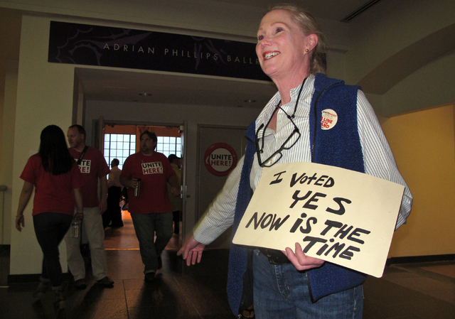 Ruthann Joyce directs members of Local 54 of the Unite-HERE union to a voting room, Thursday, June 16, 2016, in Atlantic City, N.J., as the union decides whether to authorize a strike against Ball ...