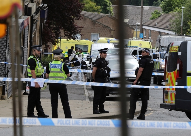 Police at the scene after Batley and Spen Member of Parliament Jo Cox was shot, in Birstall, West Yorkshire, England, Thursday June 16, 2016. (Nigel Roddis/PA via AP)