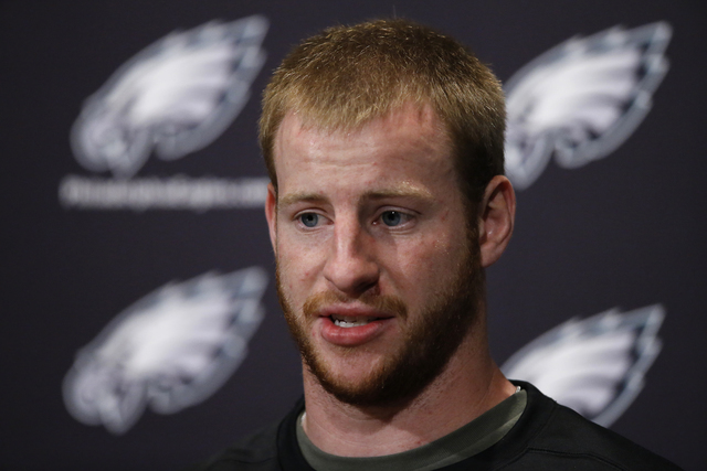In this May 31, 2016 file photo, Philadelphia Eagles quarterback Carson Wentz speaks with members of the media at the team's NFL football training facility in Philadelphia. Wentz says he became tr ...