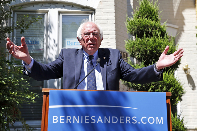 In this June 14, 2016, photo, Democratic presidential candidate, Sen. Bernie Sanders, I-Vt., speaks during a news conference outside his campaign headquarters in Washington. For Hillary Clinton an ...