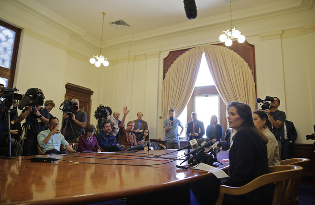 Oakland Mayor Libby Schaaf faces reporters during a news conference at City Hall Wednesday, June 15, 2016, in Oakland, Calif. Schaaf removed the interim police chief Wednesday after appointing him ...