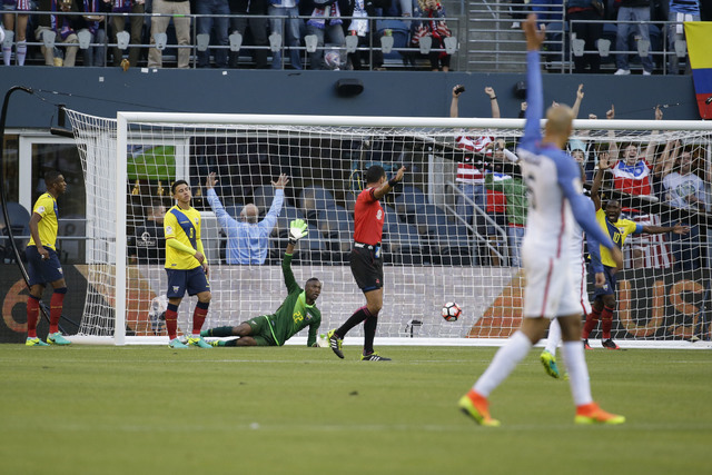 Ecuador goalkeeper Alexander Dominguez, lies on the pitch, as he reacts after United States' Gyasi Zardes scored his side's third goal during a Copa America Centenario quarterfinal soccer match, T ...