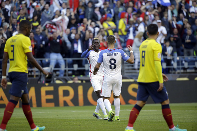 United States' Gyasi Zardes, center, is congratulated by Clint Dempsey, 8, after scoring his side's second goal against Ecuador during a Copa America Centenario quarterfinal soccer match, Thursday ...