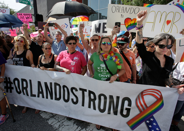 Counter demonstrators show support and solidarity near the funeral service for Christopher Andrew Leinonen, one of the victims of the Pulse nightclub mass shooting, outside the Cathedral Church of ...