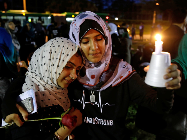 Supporters of the victims of the recent mass shooting at the Pulse nightclub attend a vigil at Lake Eola Park, Sunday, June 19, 2016, Orlando, Fla. Tens of thousands of people attended the vigil.  ...