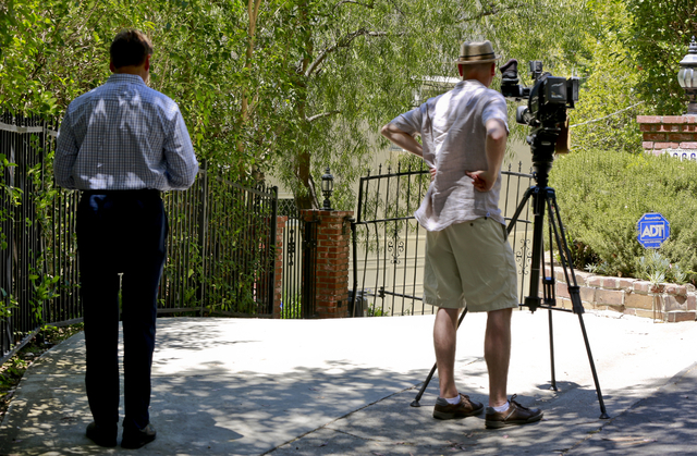 "Television reporters record the driveway to the home of Anton Yelchin, a rising actor, best known for playing Chekov in the new ""Star Trek"" films, is seen in the Studio City area ..."