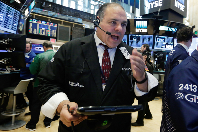 Trader Anthony Riccio works on the floor of the New York Stock Exchange, Monday, June 20, 2016. U.S. stocks are jumping Monday morning as investors grow more optimistic that Britain will remain in ...