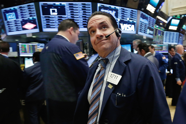 Trader Tommy Kalikas works on the floor of the New York Stock Exchange, Monday, June 20, 2016. U.S. stocks are jumping Monday morning as investors grow more optimistic that Britain will remain in  ...