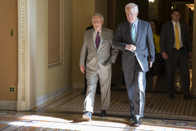 Senate Majority Leader Sen. Mitch McConnell, R-Ky., left, and Sen. John Cornyn, R-Texas, arrive for a vote on Capitol Hill, Monday, June 20, 2016, in Washington. A divided Senate hurtled Monday to ...