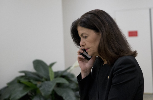 Sen. Kelly Ayotte, R-N.H., talks on a phone on Capitol Hill, Monday, June 20, 2016 in Washington. A divided Senate hurtled Monday toward an election-year stalemate over curbing guns AP Photo/Alex  ...