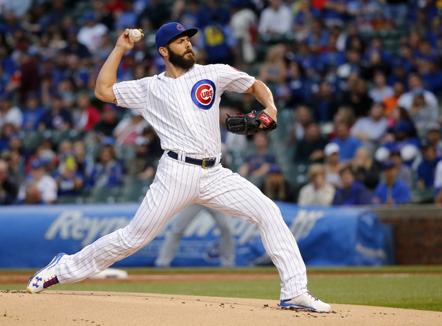 In this May 31, 2016, file photo, Chicago Cubs starting pitcher Jake Arrieta delivers during a baseball game against the Los Angeles Dodgers in Chicago. Arrieta, Denver Broncos' Von Miller and Mia ...