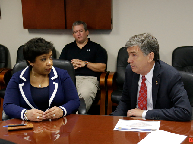 Attorney General Loretta Lynch, left, meets with U.S. Attorney Lee Bentley at the Orlando FBI office for a briefing on the Pulse nightclub mass shooting, Tuesday, June 21, 2016, in Orlando, Fla. ( ...