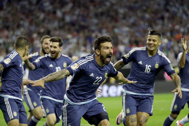 Argentina forward Ezequiel Lavezzi (22) celebrates his goal against the United States during a Copa America Centenario semifinal soccer match Tuesday, June 21, 2016, in Houston. (AP Photo/David J. ...