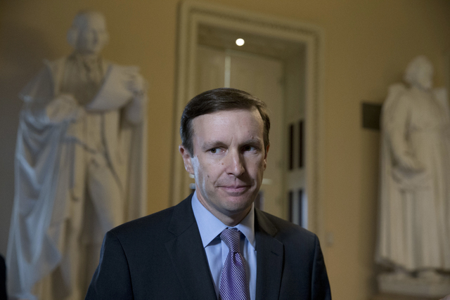 Sen. Chris Murphy, D-Conn., pauses to speak to the media as he heads to the House chamber on Capitol Hill in Washington, Wednesday, June 22, 2016, to show support for the sit-down protest, seeking ...