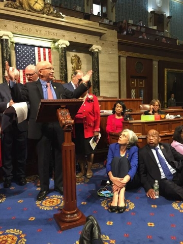 Democrat members of Congress, including, from left, Rep. Peter DeFazio, D-Ore., Rep. Katherine Clark, D-Mass., and Rep. John Lewis, D-Ga., participate in sit-down protest seeking a a vote on gun c ...