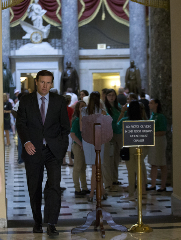 Sen. Chris Murphy, D-Conn., heads to the House chamber on Capitol Hill in Washington, Wednesday, June 22, 2016, to show support for the sit-down protest, seeking a vote on gun control measures on  ...
