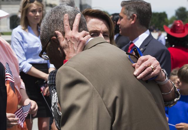 House Minority Leader Nancy Pelosi of Calif. hugs Rep. Bobby Rush, D-Ill. on Capitol Hill in Washington, Wednesday, June 22, 2016, during an news conference on gun legislation. (Evan Vucci/AP)