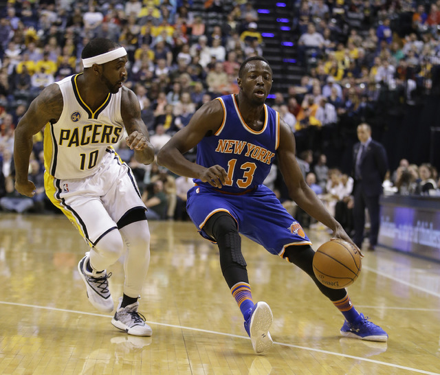In this April 12, 2016 file photo, New York Knicks' Jerian Grant (13) goes to the basket against Indiana Pacers' Ty Lawson (10) during the first half of an NBA basketball game in Indianapolis. (AP ...