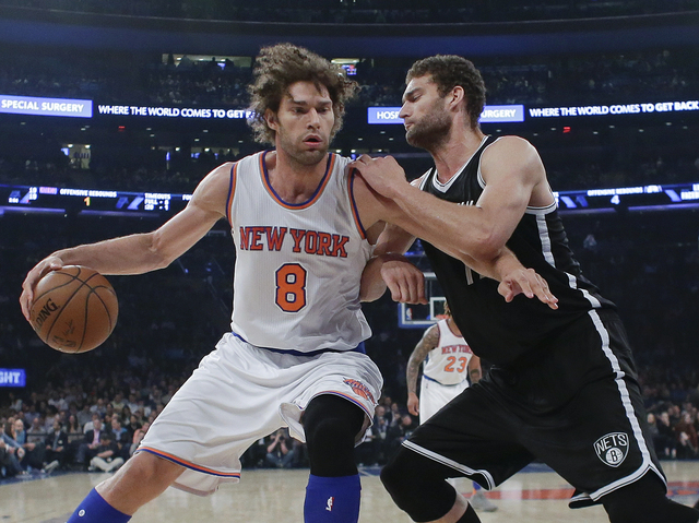 In this April 1, 2016 file photo, New York Knicks' Robin Lopez (8) is defended by Brooklyn Nets' Brook Lopez during the first half of an NBA basketball game in New York. (Frank Franklin II, file/AP)