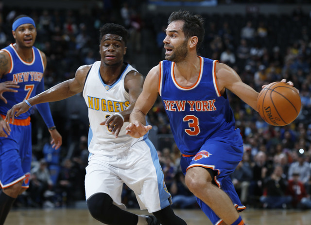In this March 8, 2016 file photo, New York Knicks guard Jose Calderon, front, of Spain, drives for a basket past Denver Nuggets guard Emmanuel Mudiay, center, as Knicks forward Carmelo Anthony loo ...
