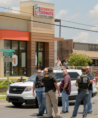 Jefferson Parish Sheriff Officers respond to the shooting death of a deputy who initiated a pedestrian stop in front of a Dunkin' Donuts Wednesday, June 22, 2016, in Harvey, La. (Matthew Hinton/Th ...