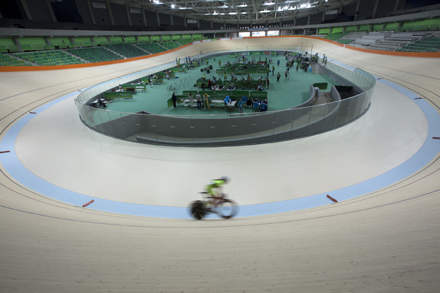 A cyclist rides his bike during a test event at the new velodrome, the last venue of the Rio 2016 Olympic Park to be delivered, in Rio de Janeiro, Brazil, Sunday, June 26, 2016. Rio will become th ...