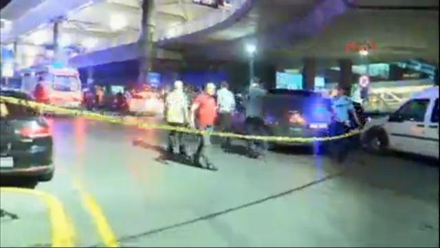 In this image taken from DHA TV, a police cordon is set up outside Istanbul's Ataturk airport, Tuesday June 28, 2016. Two explosions rocked Istanbul's Ataturk airport on Tuesday evening, according ...