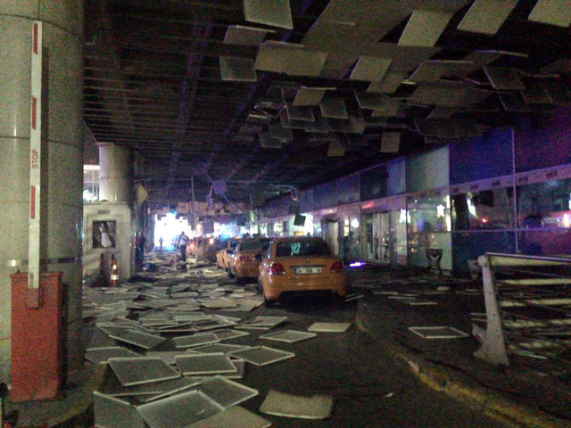 An entrance of the Ataturk Airport in Istanbul after explosions, Tuesday, June 28, 2016. Two explosions have rocked Istanbul's Ataturk airport, killing at least 10 people and wounding around 20 ot ...