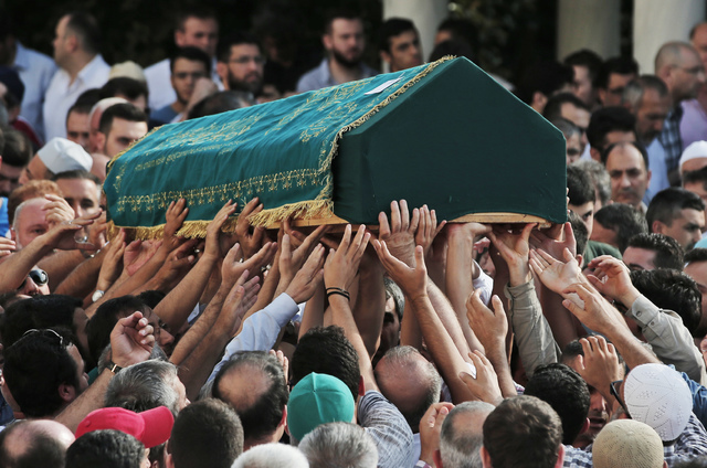 Mourners carry the coffin of Muhammed Eymen Demirci, killed Tuesday at the blasts in Istanbul's Ataturk airport, during the funeral in Istanbul's Basaksehir neighbourhood, Wednesday, June 29, 2016 ...