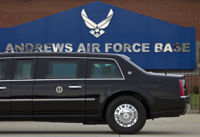 In this photo taken July 15, 2015, President Barack Obama rides in his limousine as he arrives at Joint Base Andrews, Md. Joint Base Andrews tweets that the base is on lockdown due to a report of  ...