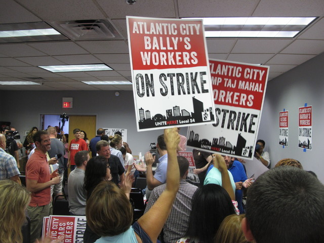 Union members cheer as they discuss preparations for a strike against as many as five of the city's eight casinos in Atlantic City, N.J. on Wednesday June 29, 2016. (Wayne Parry/AP)