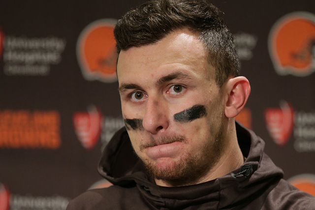 In this Dec. 20, 2015, file photo, Cleveland Browns quarterback Johnny Manziel speaks with media members following the team's 30-13 loss to the Seattle Seahawks in an NFL football game, in Seattle ...