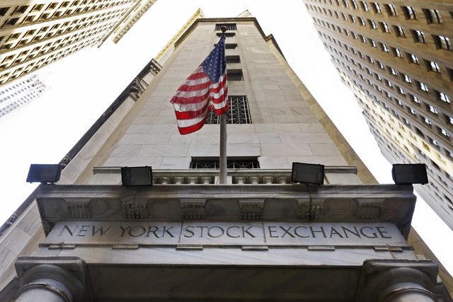 In this Friday, Nov. 13, 2015, file photo, the American flag flies above the Wall Street entrance to the New York Stock Exchange. Stocks are opening moderately higher on Wall Street on Thursday, J ...
