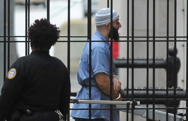 "Adnan Syed enters Courthouse East in Baltimore prior to a hearing, Feb. 3, 2016. After spending 16 years in prison for murder, Syed, who was at the center of the podcast ""Serial,"" has won a new tr ..."
