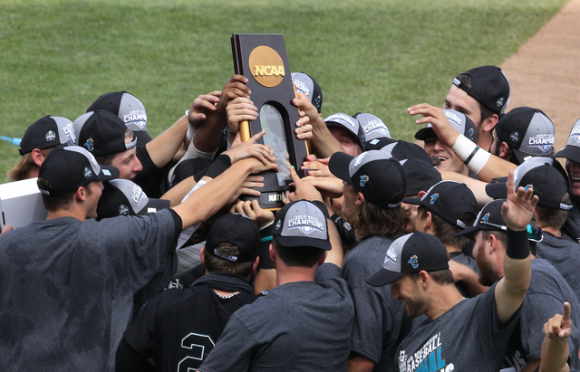 Coastal Carolina players celebrate their 4-3 victory over Arizona to win the championship after Game 3 of the NCAA College World Series baseball finals in Omaha, Neb., Thursday, June 30, 2016. (Na ...