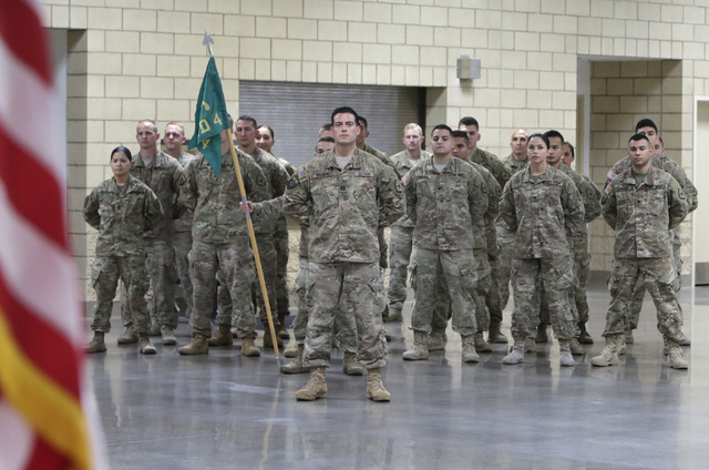 Members of the Nevada Army National Guard's 72nd Military Police Company stand at parade rest during their homecoming ceremony at North Las Vegas Readiness Center Friday, 13, 2016. Bizuayehu Tesfa ...