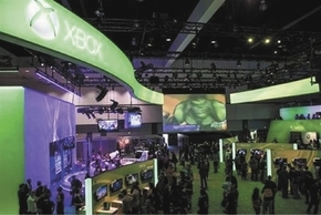 Attendees of the 2012 Electronic Entertainment Expo in Los Angeles walk past the Microsoft XBox booth.
