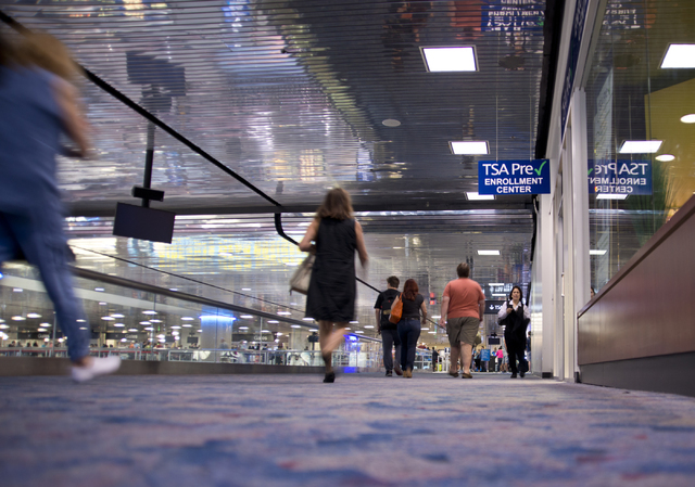 Passengers walk toward the first class and TSA PreCheck security lines at McCarran International Airport in Las Vegas on Wednesday, June 29, 2016. Daniel Clark/Las Vegas Review-Journal Follow @Dan ...