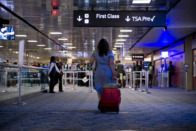 A passenger walks toward the first class and TSA PreCheck security lines at McCarran International Airport in Las Vegas on Wednesday, June 29, 2016. Daniel Clark/Las Vegas Review-Journal Follow @D ...