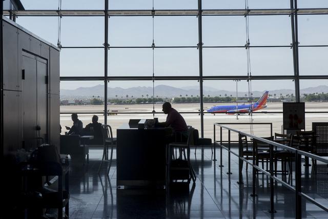 Travelers sit inside McCarran International Airport in Las Vegas on June 7, 2016. (Bridget Bennett/Las Vegas Review-Journal) Follow @bridgetkbennett