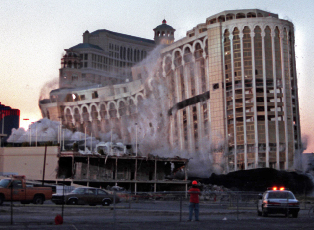 The Aladdin hotel-casino collapses under its own weight as it is imploded on the Las Vegas Strip, April 27, 1998. (Jeff Scheid/Las Vegas Review-Journal)