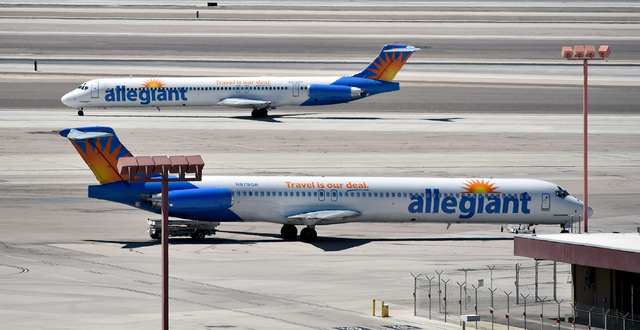 An Allegiant Air jet passes another jet at McCarran International Airport on Monday, April 27, 2015, in Las Vegas. (David Becker/Las Vegas Review-Journal)