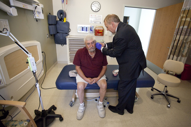 Vietnam War veteran Arthur Maheu receives acupuncture treatment for his pain from Dr. Randall James at the North Las Vegas VA Medical Center on Friday, June 3, 2016. Maheu has been getting treatme ...