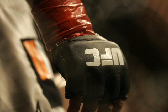 Closeup of a glove and the UFC logo at Ultimate Fighting Championship 73 on Saturday, July 7, 2007, in Sacramento, Calif. (Jeff Chiu/AP)