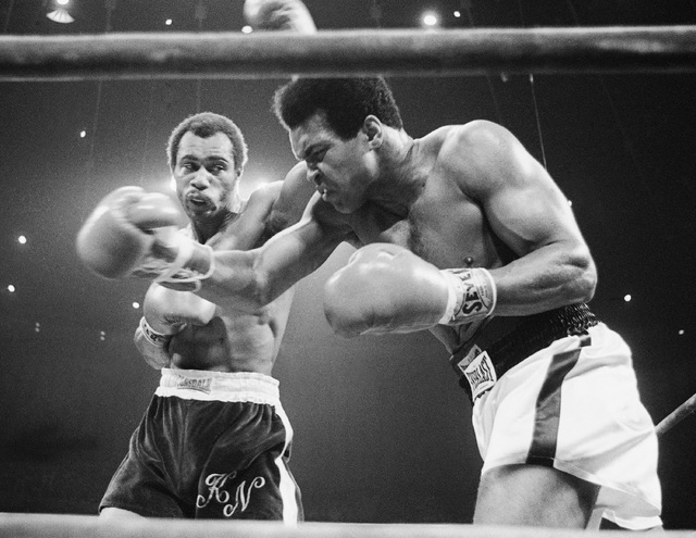 In this Sept. 10, 1973, file photo, Muhammad Ali, right, winces as Ken Norton hits him with a left to the head during their re-match at the Forum in Inglewood, Calif.  (AP Photo/File)