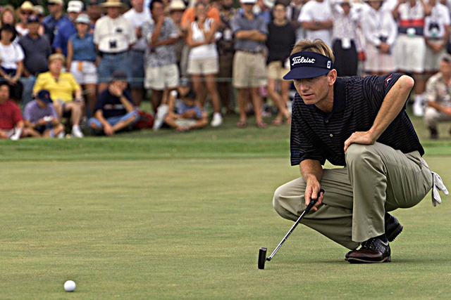 Brad Faxon eyes the green before making a birdie putt on the 16th hole to give him a 4-stroke lead and all but assuring his victory in the Sony Open played at the Waialae Country Club in Honolulu, ...