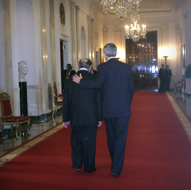 President Bush walks with the Medal of Honor awardee, Cpl. Tibor Rubin, Friday, Sept. 23, 2005, from the East Room at the White House. (Lawrence Jackson/AP)