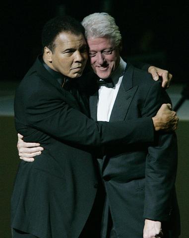Former boxer Muhammad Ali, left, hugs former U.S. President Bill Clinton as he walks onstage at the grand opening gala celebration for the Muhammad Ali Center, Saturday, Nov. 19, 2005, in Louisvil ...